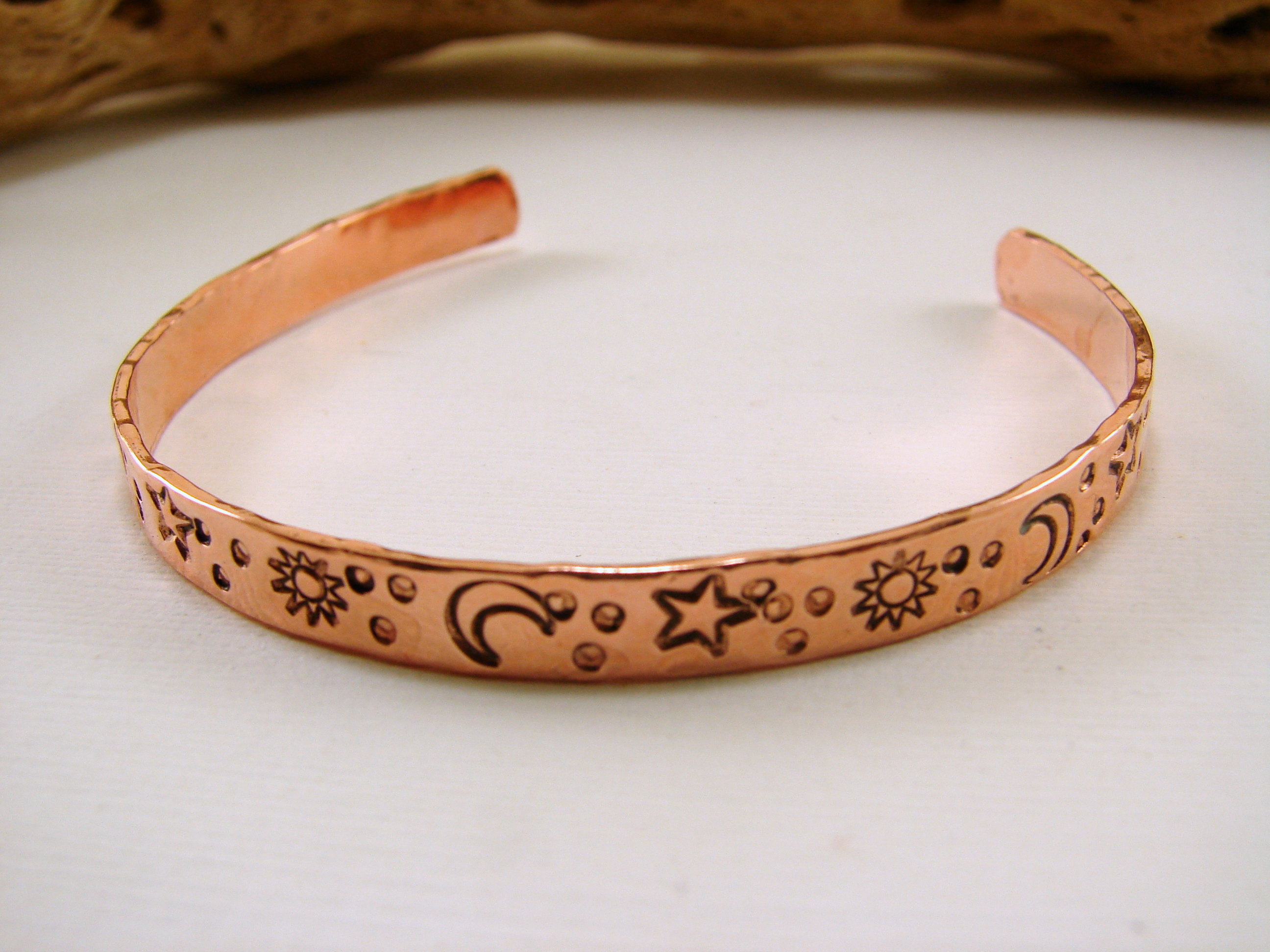 copper bracelet with sted sun moon and